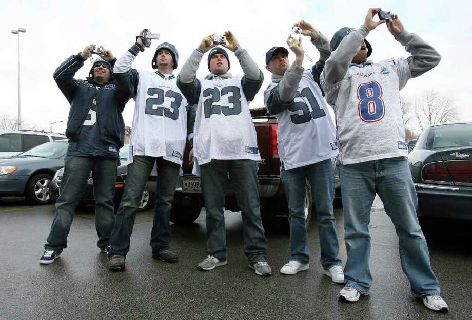 Immediately after arriving at Lambeau Field in their rented Hummer Jason Wright (blue) Sultan, Wash., Kevin Martin (23) and Michael Martin (23), both of Monroe, Wash.,  Danny Huntsinger (51), Seattle, and Bobby Kulvanish (8), from Bellevue, Wash., jumped out and started taking digital photos of the legendary facility in Green Bay, Wisconsin., Friday. Jan. 11, 2008. The group all met in Chicago and then drove the Hummer to Green Bay. Photo: Mike Urban, Seattle Post-Intelligencer / Seattle Post-Intelligencer