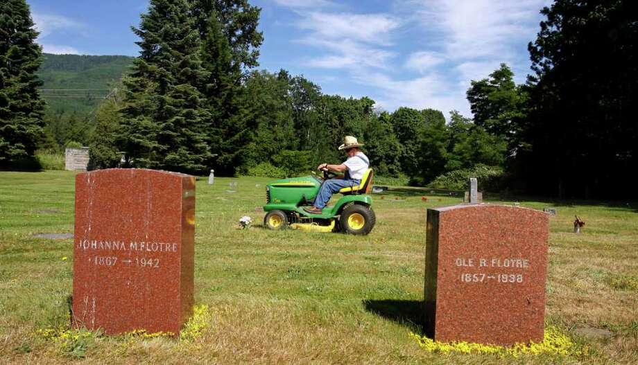 Jerry Howem trims the grass at the Immanuel Lutheran Cemetery. He has been the groundskeeper at the cemetery, on Highway 9 in Whatcom County, for more than 26 years. July 8, 2008. Arias:I stopped and talked with Jerry for a brief minute while I was working on a travel story. I believe this photo says a lot for the visual treats that await travelers down old scenic Highway 9. Photo: Gilbert W. Arias / Seattle Post-Intelligencer