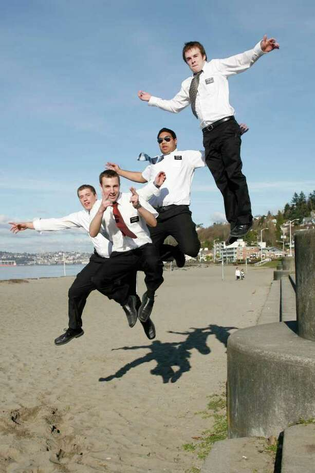 Missionaries from the Church of Jesus Christ of Latter Days Saints (l-r) Elders Beck, Cochkrell, Samani and Scott leap at Alki Beach in Seattle Thursday Feb. 28, 2007.(Seattle Post-Intelligencer/Mike Urban)