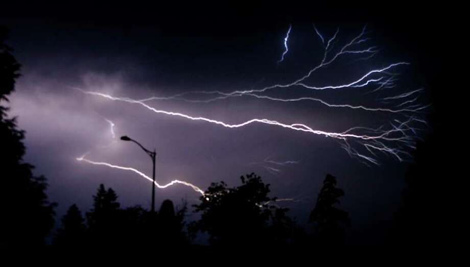 A thunderstorm passes over the Cascade Mountains, producing a spectacular lightning show, as seen from Puyallup around 10:15 p.m. on Sunday June 29, 2008. Photo: Gilbert W. Arias / Seattle Post-Intelligencer
