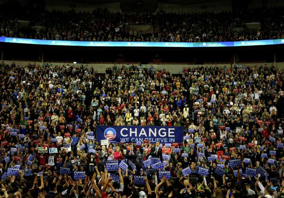 Presidential candidate Barack Obama speaks to a packed house during a rally on Friday, February 8, 2008 at Key Areana in Seattle. (Photo/Seattle Post-Intelligencer, Joshua Trujillo)