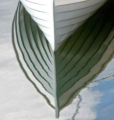 The lines of a Lake Oswego Boat reflects in the weater at the Center