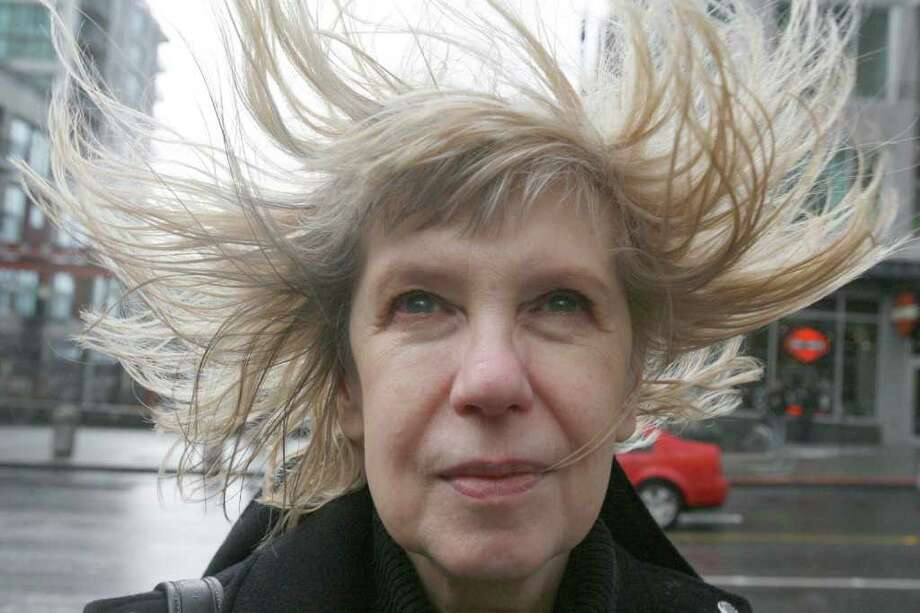 The wind blows through Olga Bourlin's hair as she stands on a corner at First Avenue and University Streets.  Seattle, WA. Tuesday, February 5, 2008 Photo: Grant M. Haller, Seattle Post-Intelligencer / Seattle Post-Intelligencer