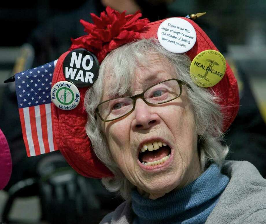 """We cover many demonstrations in a year and you try to come up with a feature photo that captures the spirit of the event. Here, Seattle Raging Granies Shirley Morrison belts out an anti-war song during rally at Pier 66. Marchers gathered at Jack Perry Park and for the  """"May Day March & Rally"""" and marched North on East Marginal Way to Alaskan Way for a rally at the Port of Seattle's Pier 66. Thursday, May 1, 2008. Seattle. Photo: Grant M. Haller, Seattle Post-Intelligencer / Seattle Post-Intelligencer"""
