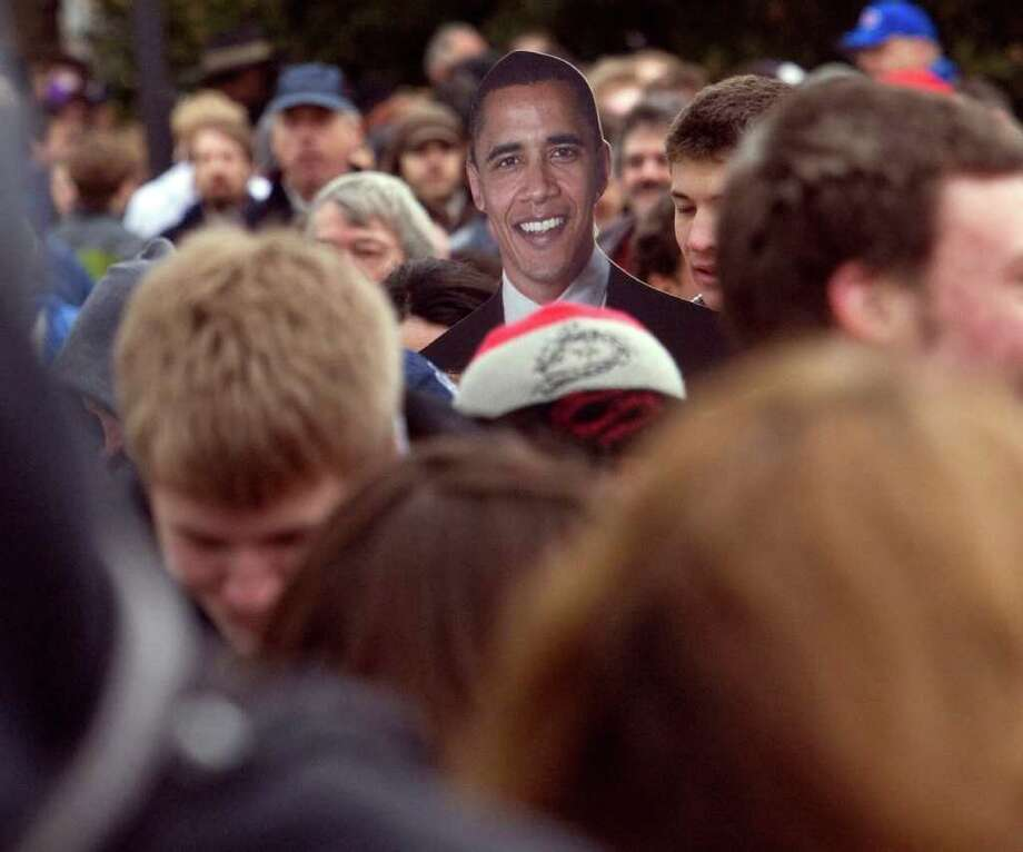 After Barack Obama's 2007 December visit to Seattle the numbers of his supporters grew to make an overflow crowd at the Key Arena in February.   For a moment it looked like Barack Obama was in line along 1st Ave. North to see himself speak at the Key Arena. The full-size cutout of Obama was carried by Lakeside student Kelly VanArsdale, 18. . Friday, February 8, 2008 Photo: Grant M. Haller, Seattle Post-Intelligencer / Seattle Post-Intelligencer