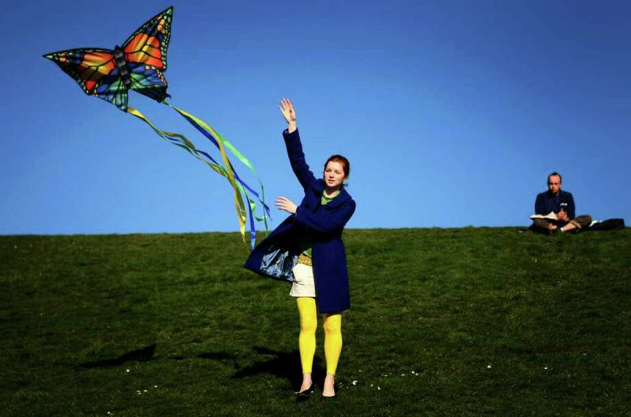 Aubrey Mayne helps launch a kite on a sunny day at Gas Works Park on February 18, 2008. The nanny and her three young charges were enjoying a day off from school at the park. Photo: Joshua Trujillo, Seattle Post-Intelligencer / Seattle Post-Intelligencer