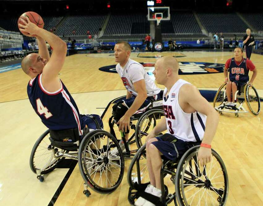 Paul Schulte, of Bradenton, Fla., shoots over Jeff Glassbrenner, center, and Jeremy Lade, of Janesville, Wis., during an exhibition at the Final Four at Reliant Stadium Friday, April 1, 2011, in Houston. ( Brett Coomer / Houston Chronicle )