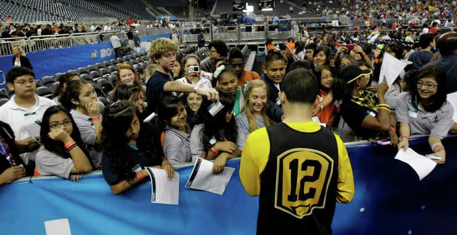 Virginia Commonwealth guard Joey Rodriguez (12) signs autographs after VCU's open practice at Reliant Stadium, Friday, April 1, 2011, in Houston, as teams prepare for the Final Four games to begin.   ( Karen Warren / Houston Chronicle ) Photo: Karen Warren, Houston Chronicle / Houston Chronicle for the Connecticut Post