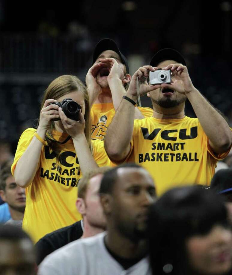 Virginia Commonwealth fans take photos during VCU's open practice at Reliant Stadium, Friday, April 1, 2011, in Houston, as teams prepare for the Final Four games to begin.   ( Karen Warren / Houston Chronicle ) Photo: Karen Warren, Houston Chronicle / Houston Chronicle for the Connecticut Post