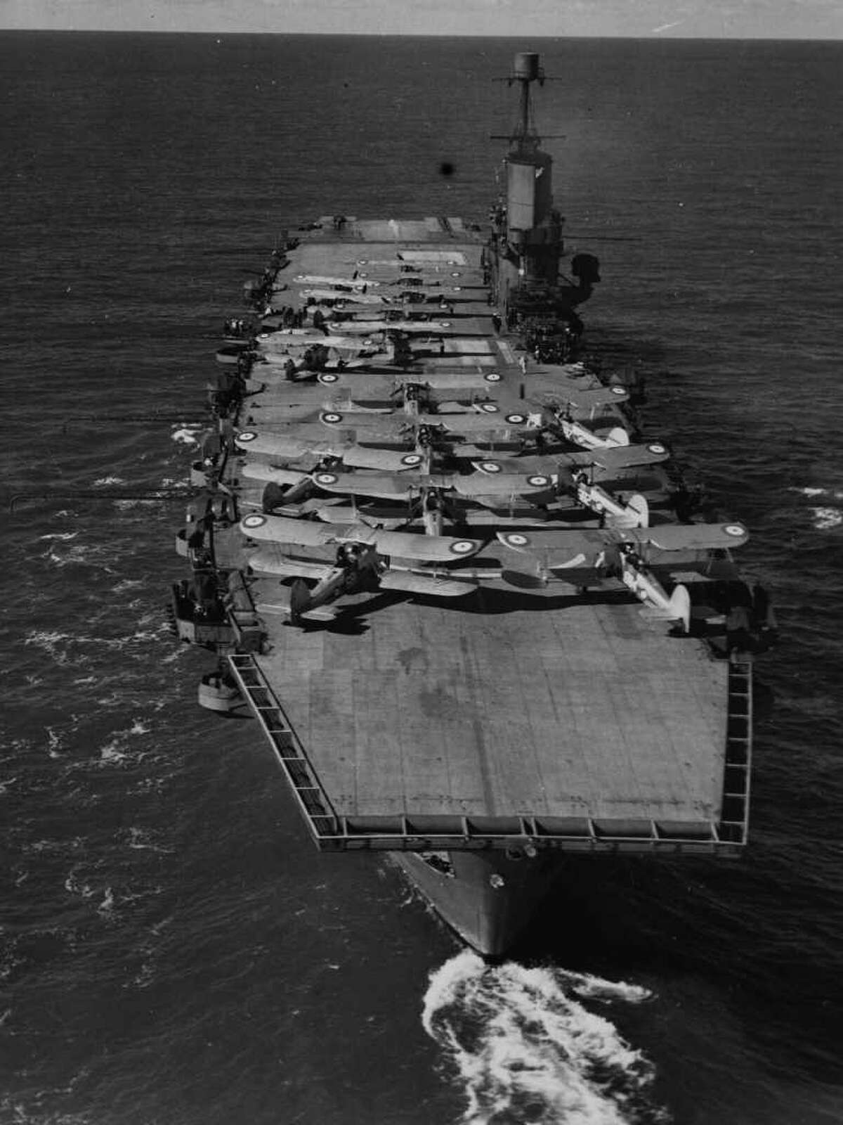 Airplanes prepare for take off from the flight deck of second HMS Ark Royal, circa 1935. Related story