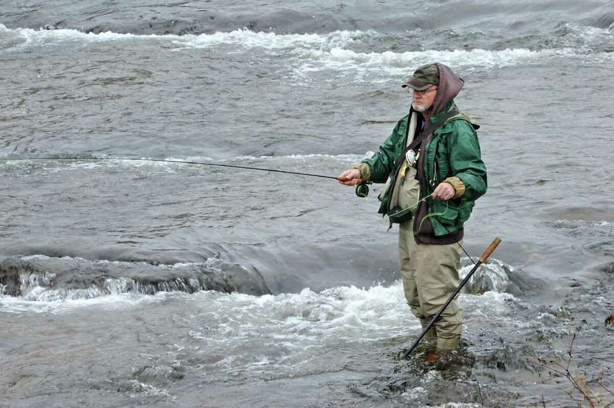 Jim Danker of Glenville uses his fly rod on a rainy first day of trout fishing season in Rock City Falls, N.Y., on Friday afternoon April 1, 2011. Danker did catch a small brown trout. (Lori Van Buren / Times Union)