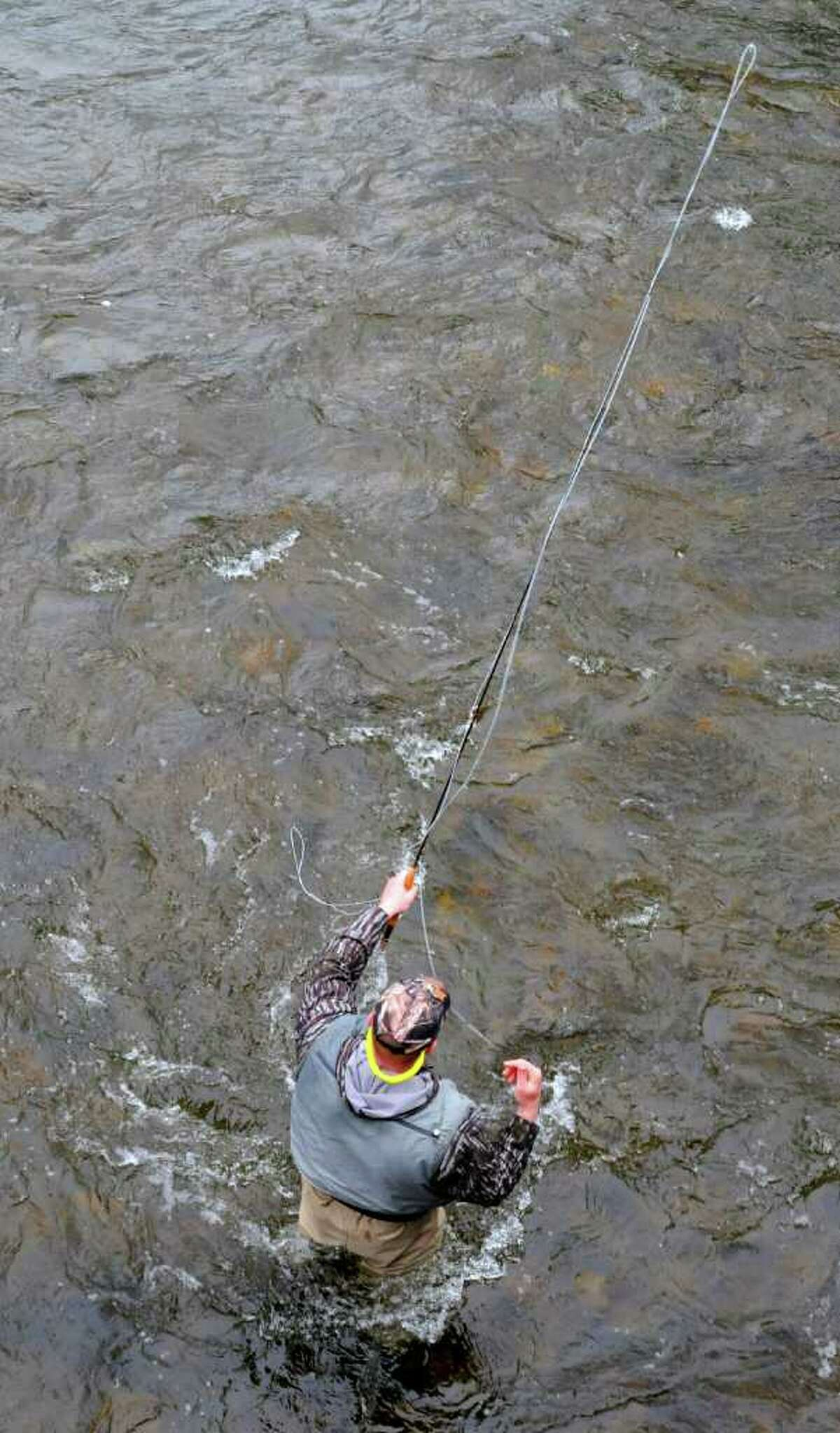 Josh Velicky of Clifton Park uses his fly rod on a rainy first day of trout fishing season in Factory Village, N.Y., on Friday afternoon, April 1, 2011. (Lori Van Buren / Times Union)