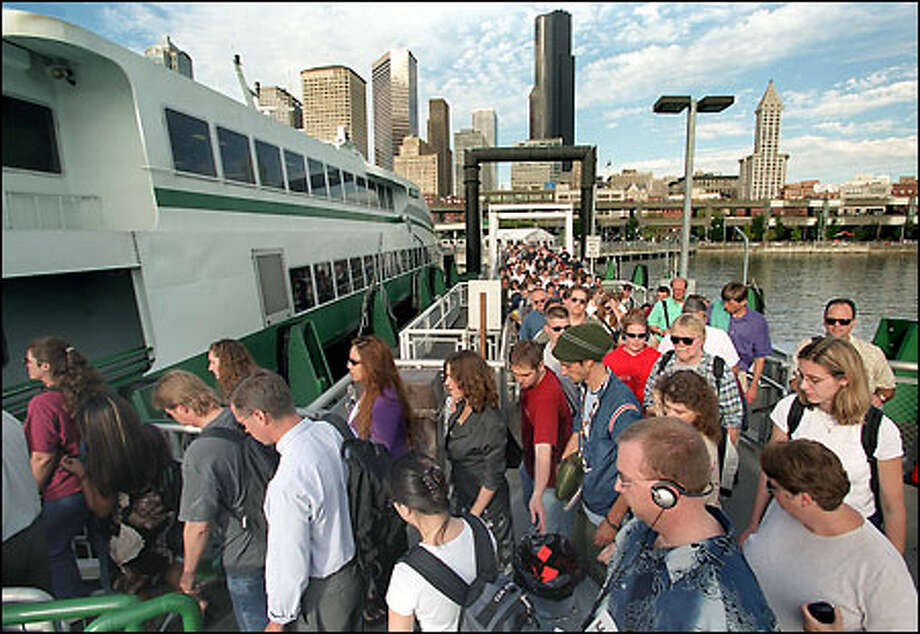 Foot-passengers board the sold-out MV Chinook for the 5:40 p.m. commuter trip to Bremerton. (Grant M. Haller / Seattle P-I)