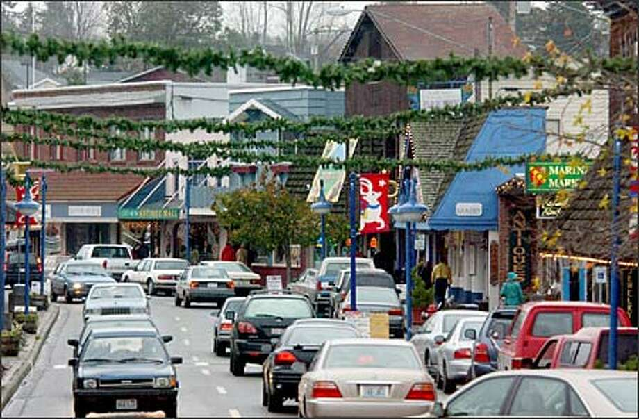 Downtown Poulsbo is especially popular during the holidays. On-street parking is limited, but there's plenty of free off-street parking. (Jeff Larsen / Seattle P-I)