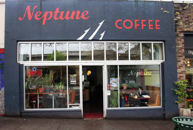 Neptune offers a wide range of drinks -- not just your average cup of coffee. You can have coffee, beer or a glass of wine. (William Baldon / seattlepi.com)