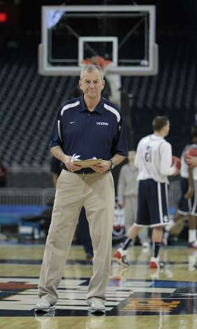 Connecticut head coach Jim Calhoun watches his players run drills during the University of Connecticut open team practice in preparation for the Final Four at Reliant Stadium onFriday, April 1, 2011, in Houston.  ( Karen Warren / Houston Chronicle ) Photo: Karen Warren, Houston Chronicle / Houston Chronicle for the Connecticut Post