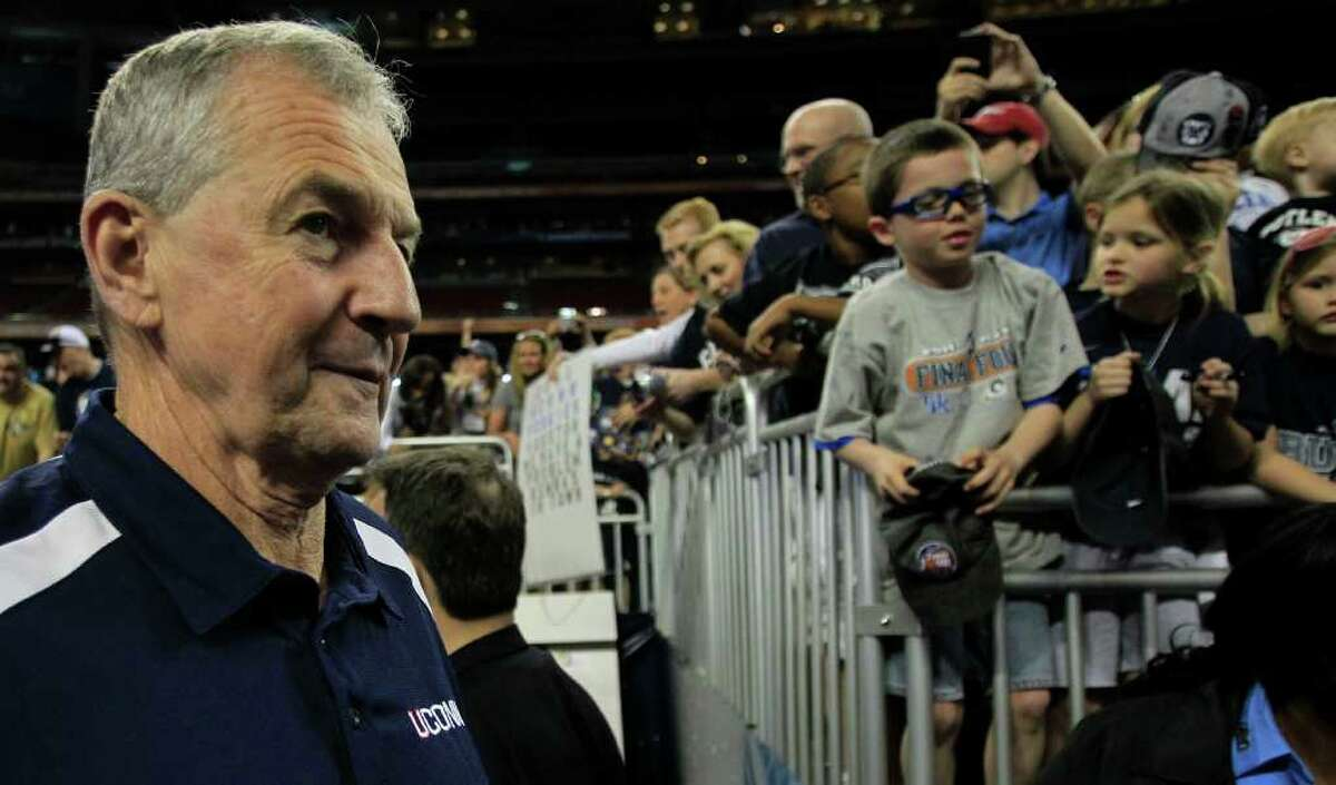 Connecticut head coach Jim Calhoun walks to the court before his team's practice before the Final Four at Reliant Stadium Friday, April 1, 2011, in Houston. ( Brett Coomer / Houston Chronicle )