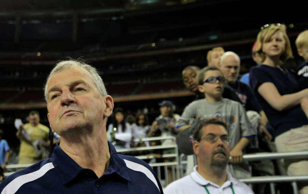 Connecticut head coach Jim Calhoun walks to the court as his team walks to practice before the Final Four at Reliant Stadium Friday, April 1, 2011, in Houston. ( Brett Coomer / Houston Chronicle )