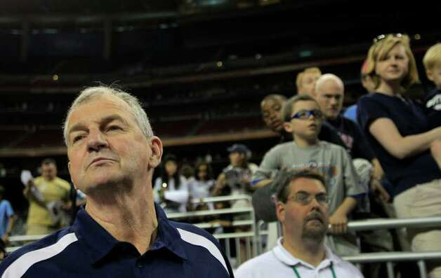Connecticut head coach Jim Calhoun walks to the court as his team walks to practice before the Final Four at Reliant Stadium Friday, April 1, 2011, in Houston. ( Brett Coomer / Houston Chronicle ) Photo: Brett Coomer, Houston Chronicle / Houston Chronicle for the Connecticut Post