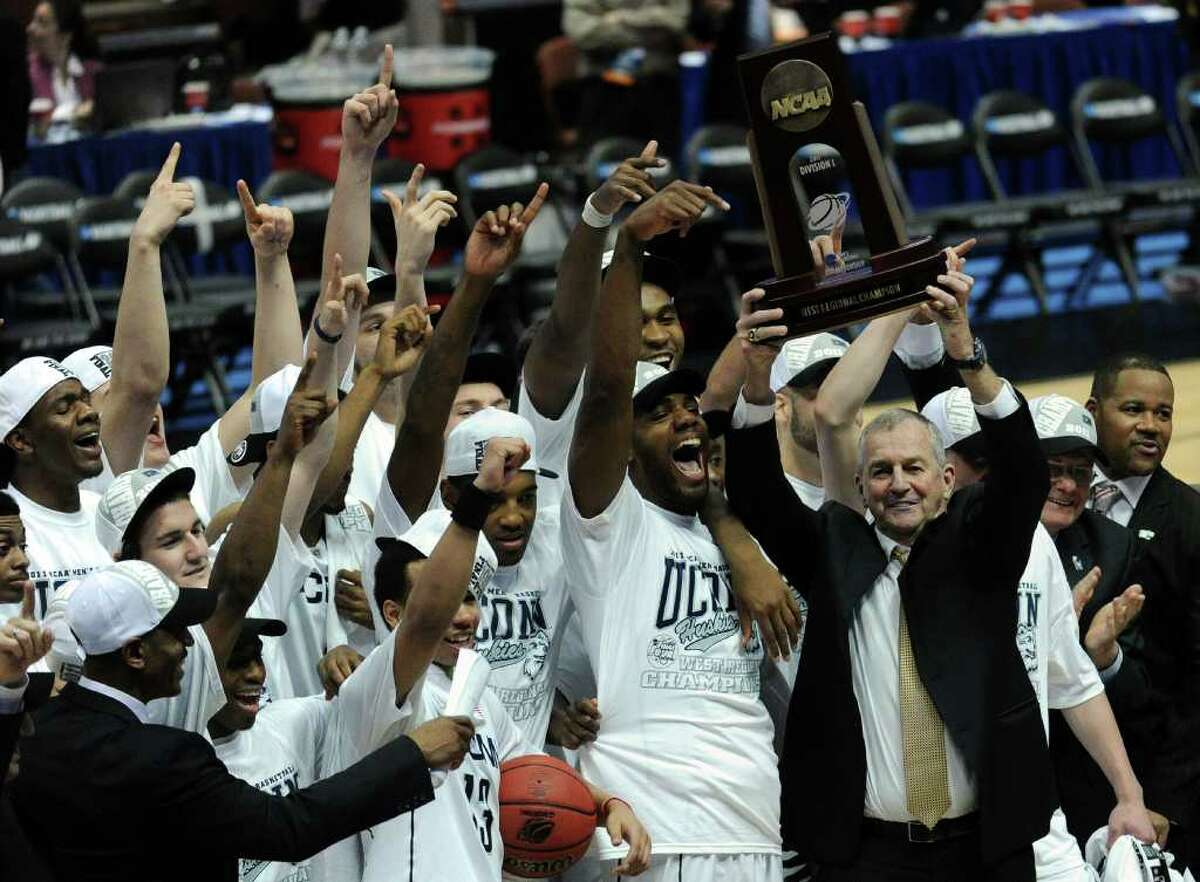 ANAHEIM, CA - MARCH 26: Head coach Jim Calhoun and the Connecticut Huskies celebrate after defeatng the Arizona Wildcats to win the west regional final of the 2011 NCAA men's basketball tournament at the Honda Center on March 26, 2011 in Anaheim, California. (Photo by Harry How/Getty Images) *** Local Caption *** Jim Calhoun