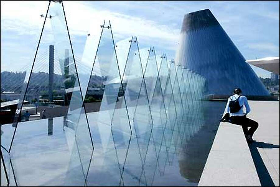 Reflecting pools, art installations and panoramic views draw visitors to the roof of the Museum of Glass. (Gilbert W. Arias/Seattle P-I file)