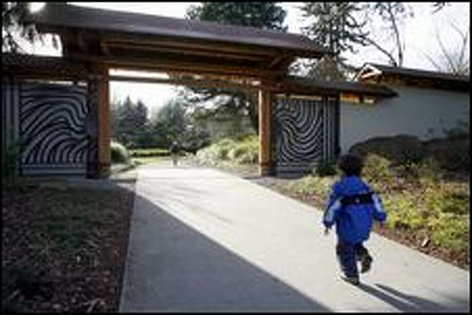Young visitors race into the Kubota Gardens in Southeast Seattle. (Gilbert W. Arias / Seattle P-I)