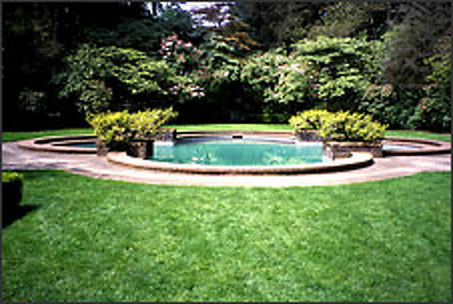 The Thomas Church-designed quatrefoil pool at Lakewold Gardens. (Marty Wingate / special to Seattle P-I)