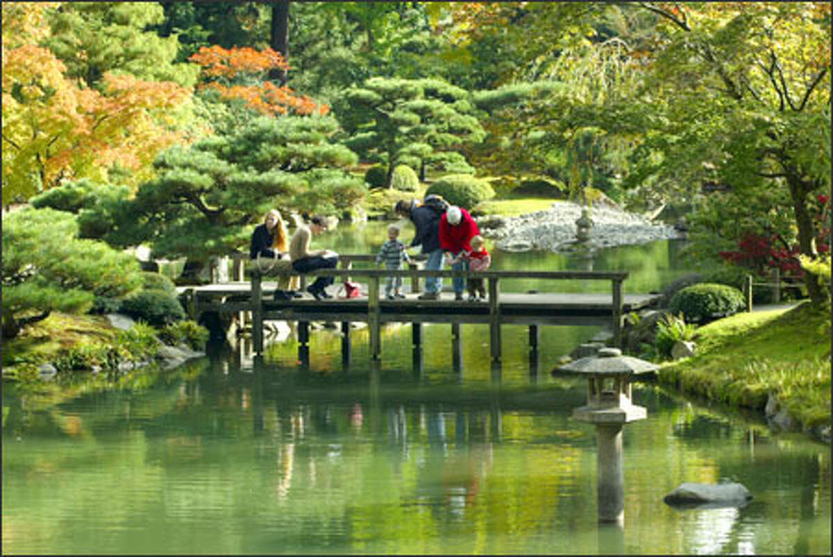 A break in the clouds brings some color to an otherwise gloomy autumn day at the Japanese Garden in Seattle's Washington Park Arboretum. (Grant M. Haller / Seattle P-I)