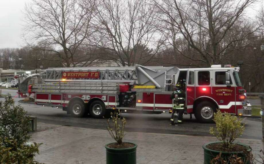 The Westport Fire Department's new ladder-tower truck repsonds to its first call Friday. Photo: Contributed Photo/Westport Fire Department / Westport News contributed