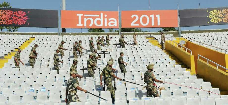 Central Reserve Police Force (CRPF) bomb-squad officials search the empty stadium with sniffer dogs prior to the start of an ICC Cricket World Cup 2011 second semi-final match between India and Pakistan at The Punjab Cricket Associaton (PCA) Stadium in Mohali on March 30, 2011.  The teams clash in the semi-final of the competition in a battle promising passion and drama, with more than a billion people, or a fifth of humanity, set to follow the much-hyped contest between bat and ball.   AFP PHOTO/Indranil MUKHERJEE Photo: INDRANIL MUKHERJEE, AFP/Getty Images / 2011 AFP
