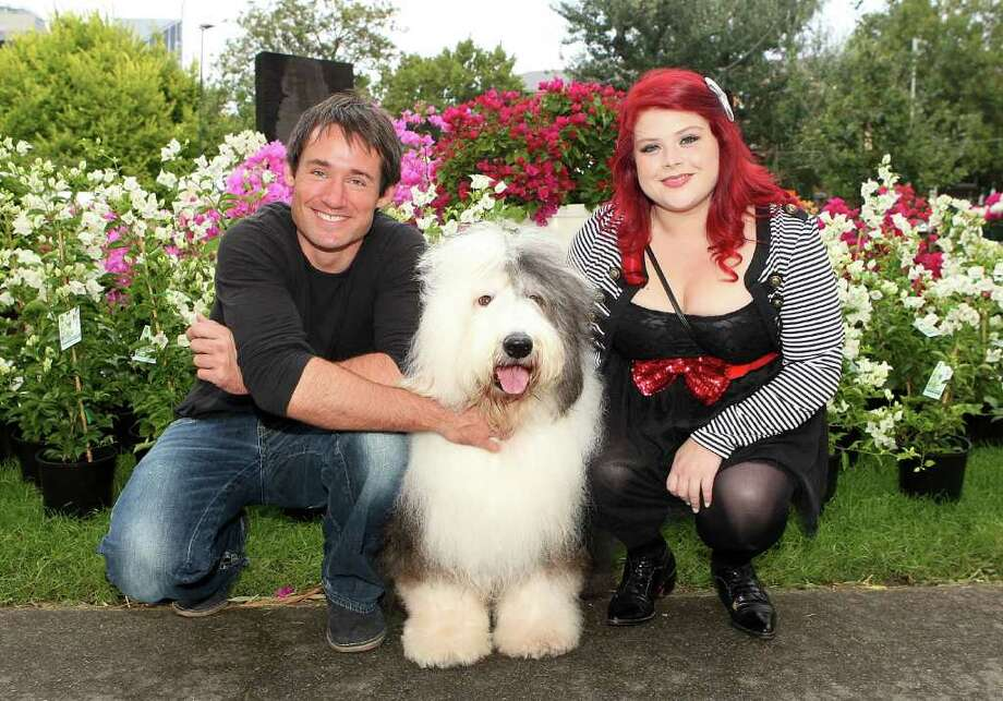 MELBOURNE, AUSTRALIA - MARCH 30:  TV personalities Tom Wren (L) and Melissa Bergland (R) pose with a dog at the Melbourne International Flower and Garden Show at Carlton Gardens on March 30, 2011 in Melbourne, Australia. The show is the largest event of it's kind in the southern hemisphere and is open to the public from March 30 - April 3.  (Photo by Graham Denholm/Getty Images) *** Local Caption *** Melissa Bergland;Tom Wren Photo: Graham Denholm, Getty Images / 2011 Getty Images