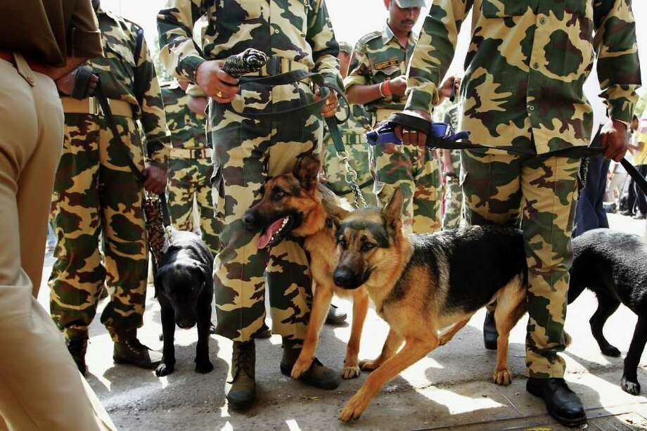 MOHALI, INDIA - MARCH 29:  Indian security forces and their dogs line up to work at the Punjab Cricket Association Ground on March 29, 2011 in Mohali, India. India will play Pakistan in the ICC World Cup Semi-Final on Wednesday. Photo: Daniel Berehulak, Getty Images / 2011 Getty Images
