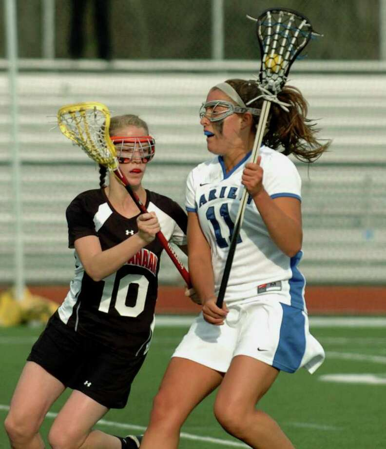 New Canaan's #11 Liz Detour works to get around Darien's #10 Ellie Bullit, during Class M title lacrosse action in Darien, Conn. on Friday April 09, 2010. New Canaan lost to Darien 12-7. Photo: Christian Abraham, ST / Connecticut Post