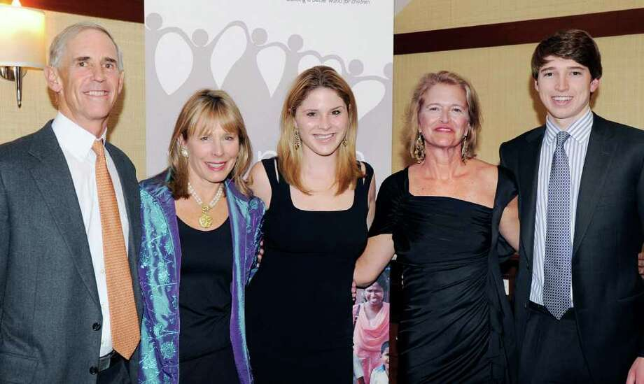 "Rick and Jill Woolworth, husband and wife of Greenwich at left, and Lisa Foley and her son, Thomas Foley Jr., at right, also of Greenwich, pose with Jenna Bush Hager, center, daughter of former U.S. President George W. Bush, during the Women of Vision's 10-year anniversary event, ""10 Years of Changing Hearts and Changing Lives,"" at Burning Tree Country Club, Greenwich, Friday night, April 1, 2011. Jill Woolworth and Lisa Foley are the Women of Vision Fairfield County chapter founders. Photo: Bob Luckey / Greenwich Time"