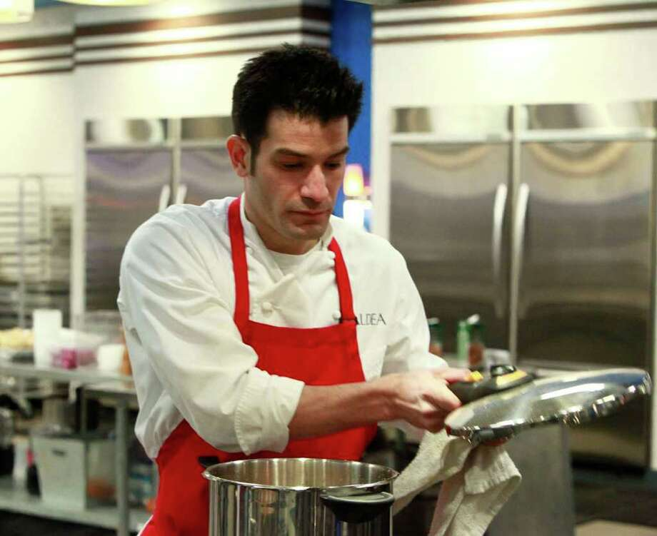"George Mendes, who grew up in Danbury and worked as a teen at The Sycamore in Bethel, now is co-owner of Aldea, a Manhattan restaurant. He is also among the competitors on Bravo's new season of ""Top Chef Masters."" The show pits 12 world-renowned chefs against each other in a fierce culinary competition. The winner receives $100,000 for the charity of his, or her, choice. Photo: Contributed Photo/Nicole Wilder/Bravo, Contributed Photo / The News-Times Contributed"