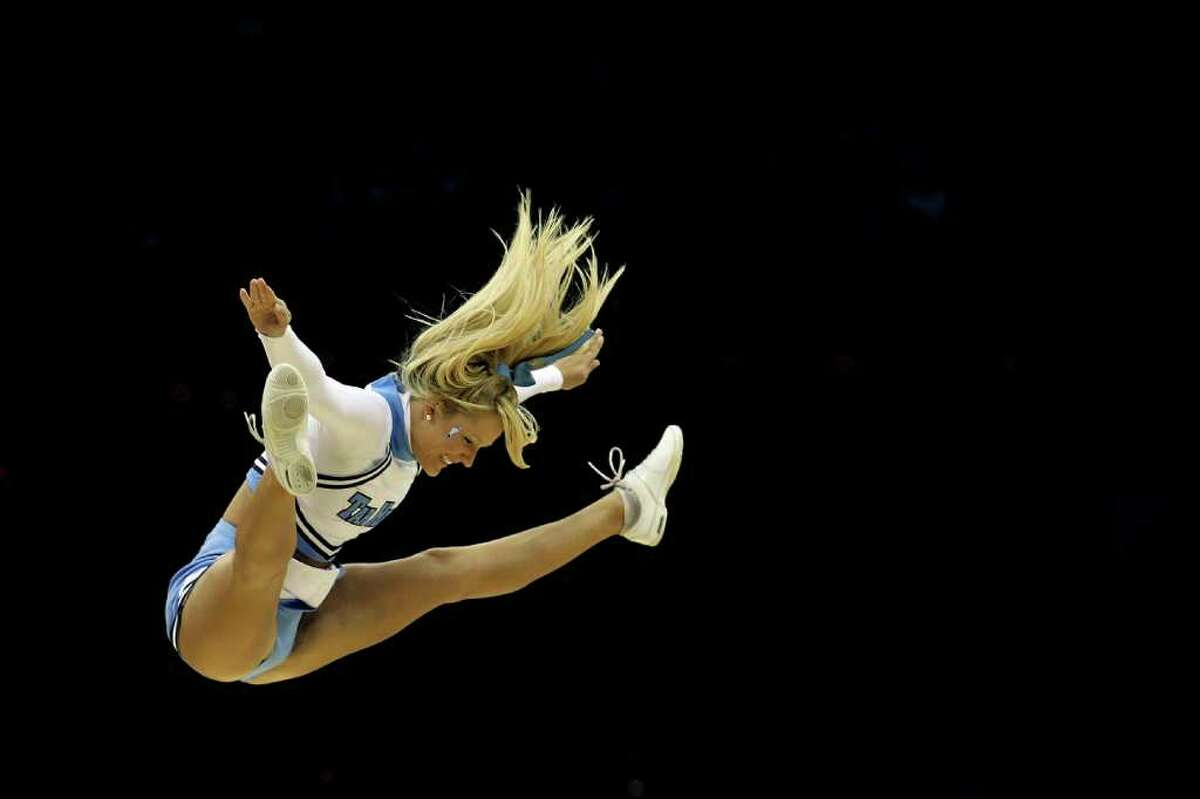A North Carolina Tar Heels cheerleader performs while playing the Kentucky Wildcats in the east regional final of the 2011 NCAA men's basketball tournament at Prudential Center on March 27, 2011 in Newark, New Jersey.