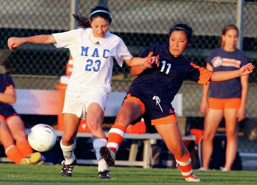FOR SPORTS - MacArthur's Marissa Allen and Brandeis' Yuri Takano struggle for position on the ball during overtime action Friday April 1, 2011 at Blossom Soccer Stadium. MacArthur won 1-0. (PHOTO BY EDWARD A. ORNELAS/eaornelas@express-news.net)