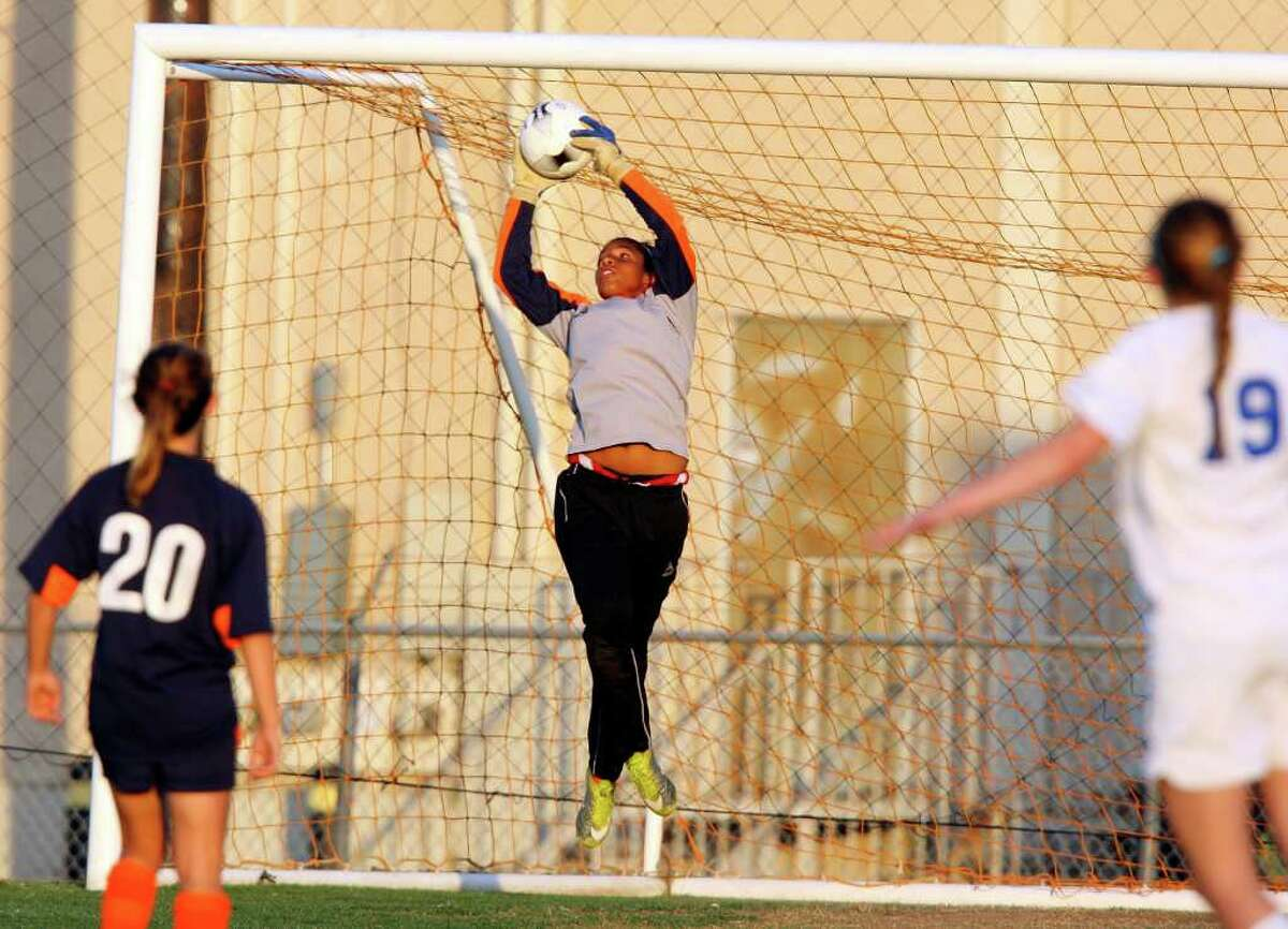 FOR SPORTS - Brandeis' Lauren Blakes makes a save against MacArthur during overtime action Friday April 1, 2011 at Blossom Soccer Stadium. MacArthur won 1-0. (PHOTO BY EDWARD A. ORNELAS/eaornelas@express-news.net)