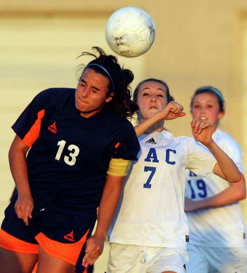 FOR SPORTS - Brandeis' Maddie Harwerth and MacArthur's Brianna Livecchi  go up for the ball during overtime action Friday April 1, 2011 at Blossom Soccer Stadium. MacArthur won 1-0.   (PHOTO BY EDWARD A. ORNELAS/eaornelas@express-news.net) / SAN ANTONIO EXPRESS-NEWS (NFS)