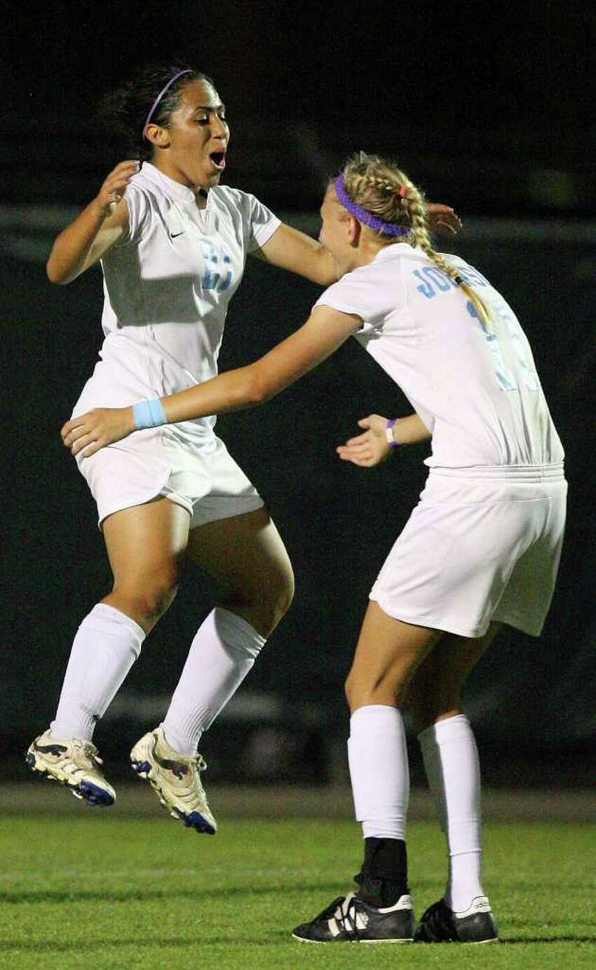 Johnson's Jazma Latu (left) celebrates with teammate Johnson's Sharis Lachappelle after scoring a goal against Marshall during second half action Friday April 1, 2011 at Blossom Soccer Stadium. Johnson won 3-0. Lachappelle also scored a goal in the second half. (PHOTO BY EDWARD A. ORNELAS/eaornelas@express-news.net)