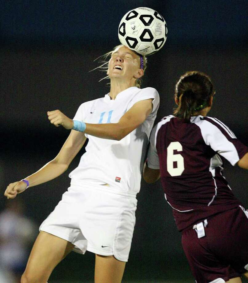 Johnson's Sharis Lachappelle heads the ball around Marshall's Sara Coronado during first half action Friday April 1, 2011 at Blossom Soccer Stadium.   (PHOTO BY EDWARD A. ORNELAS/eaornelas@express-news.net) / SAN ANTONIO EXPRESS-NEWS (NFS)