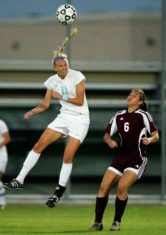 Johnson's Sharis Lachappelle goes up for a header against  Marshall's Sara Coronado during first half action Friday April 1, 2011 at Blossom Soccer Stadium.   (PHOTO BY EDWARD A. ORNELAS/eaornelas@express-news.net) / SAN ANTONIO EXPRESS-NEWS (NFS)