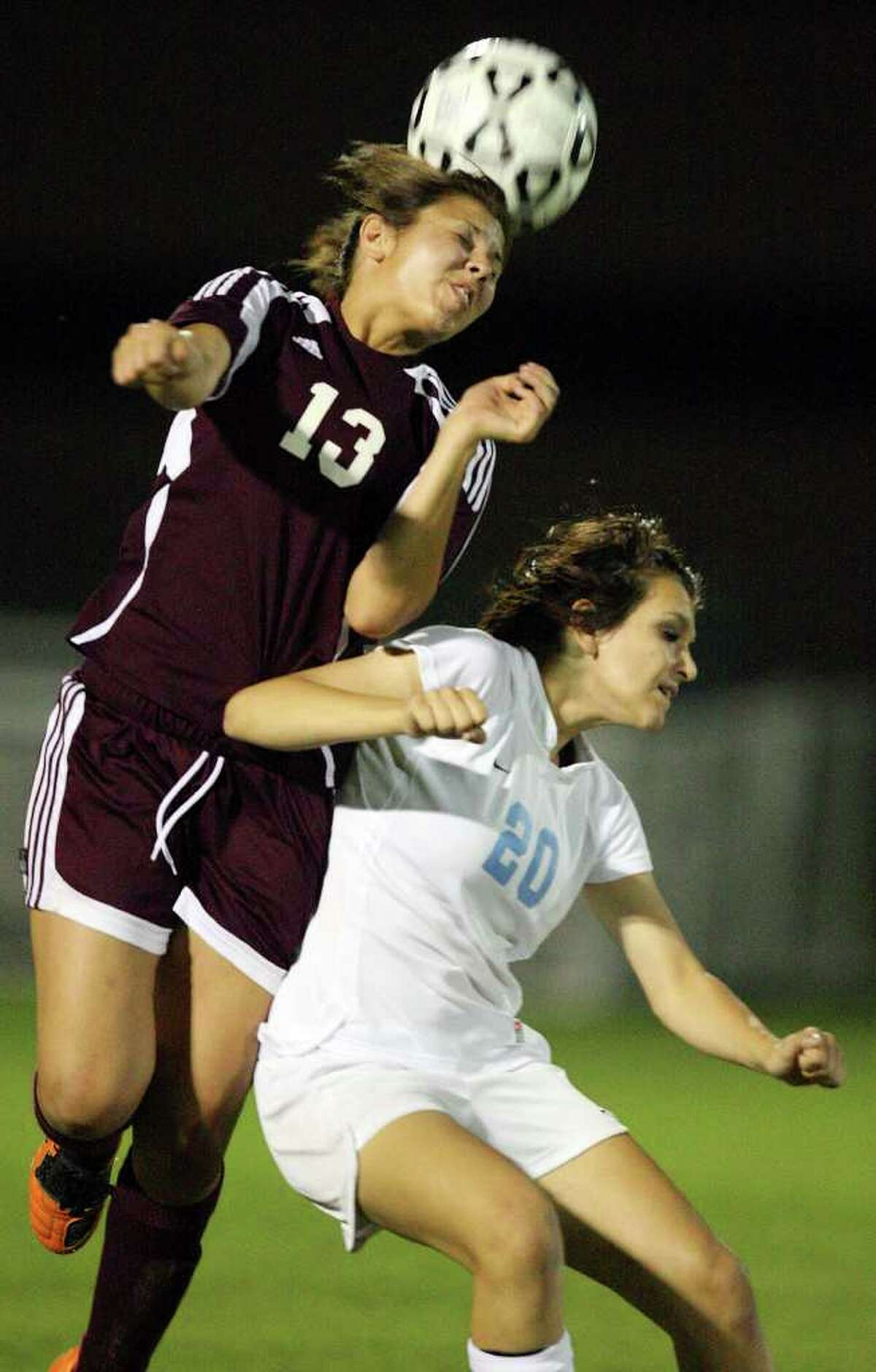 Marshall's Brianna Brune heads the ball over Johnson's Tiana Soulas during second half action Friday April 1, 2011 at Blossom Soccer Stadium. Johnson won 3-0. (PHOTO BY EDWARD A. ORNELAS/eaornelas@express-news.net)