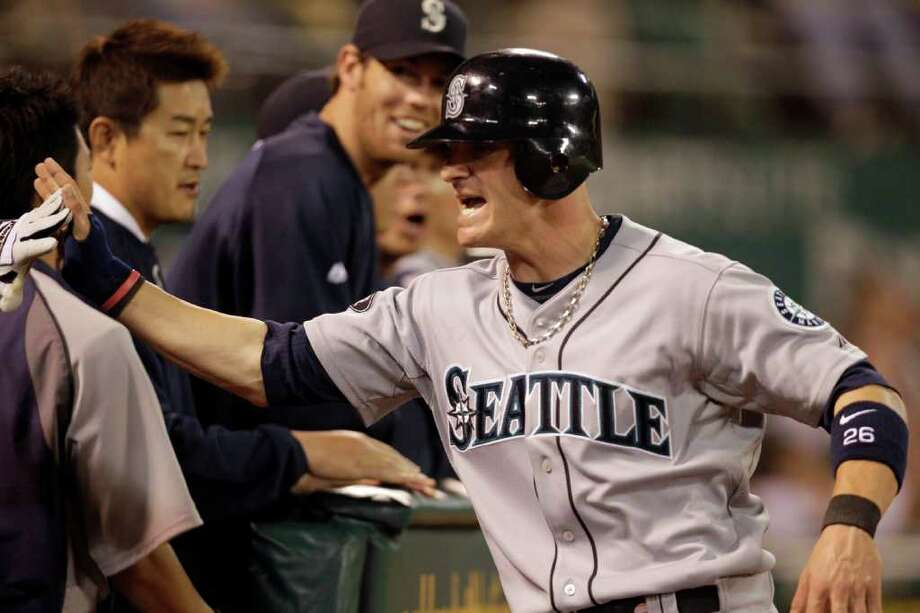 Seattle Mariners' Brendan Ryan, right, is congratulated after scoring against the Oakland Athletics during the sixth inning of a baseball game Friday, April 1, 2011, in Oakland, Calif. Photo: AP