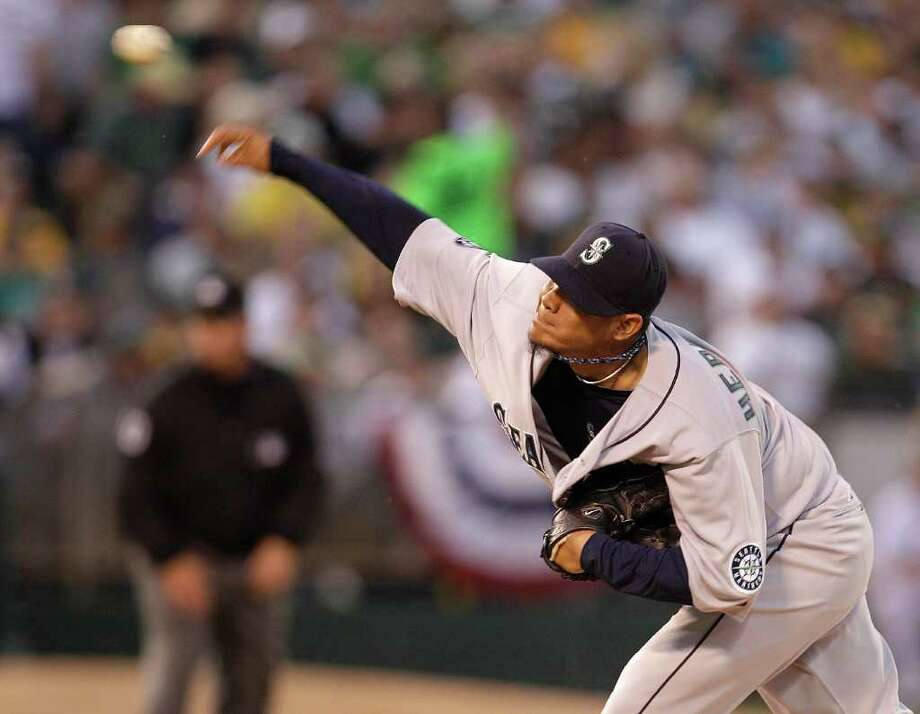Seattle Mariners' Felix Hernandez works against the Oakland Athletics during the first inning of a baseball game Friday, April 1, 2011, in Oakland, Calif. Photo: AP