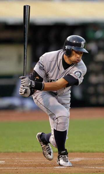Seattle Mariners' Ichiro Suzuki, of Japan, swings at a pitch from Oakland Athletics' Trevor Cahill d