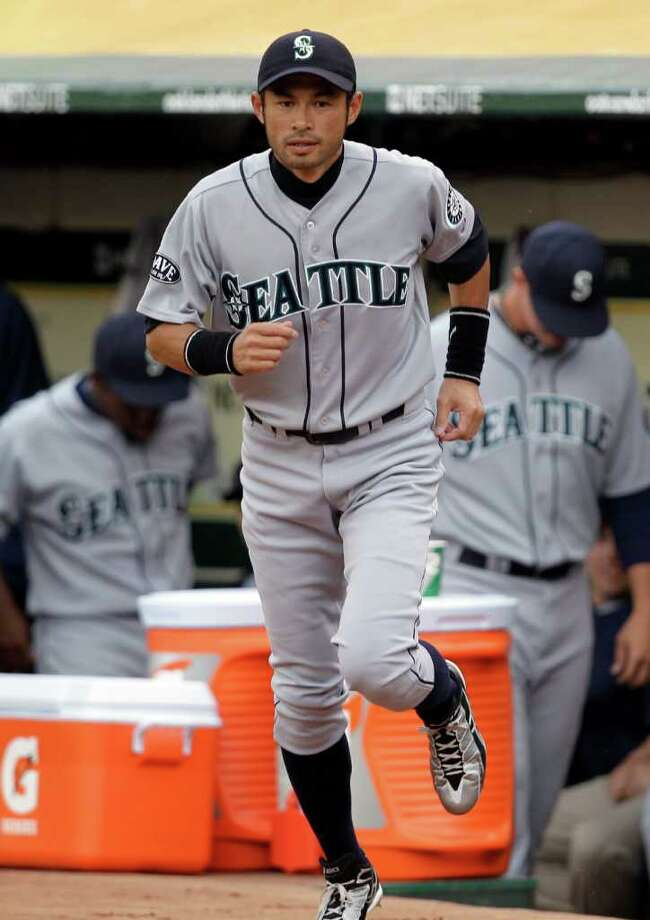 Seattle Mariners' Ichiro Suzuki, of Japan,  runs onto the field prior to the baseball game against the  Oakland Athletics Friday, April 1, 2011, in Oakland, Calif. Photo: AP
