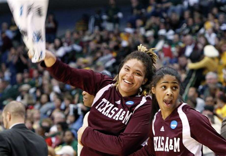 Texas A&M's Danielle Adams (left) and Sydney Colson celebrate after Texas A&M defeated Georiga in last weekend's NCAA regional. (AP Photo/LM Otero)