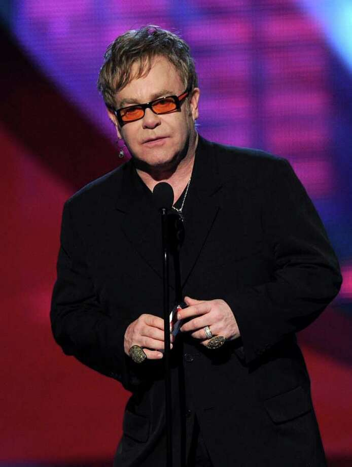 Musician Elton John speaks onstage during the 2011 People's Choice Awards at Nokia Theatre on January 5, 2011 in Los Angeles. (Photo by Kevin Winter/Getty Images) Photo: Kevin Winter, ST / 2011 Getty Images