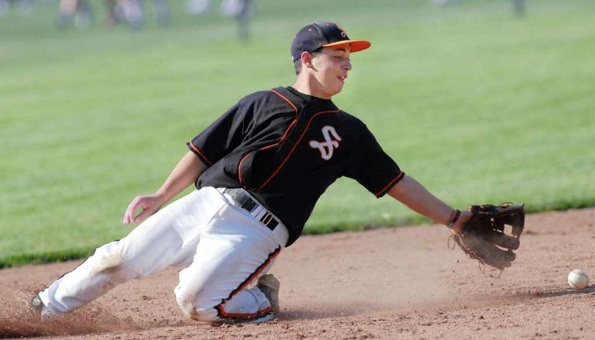 Stamford High School second baseman, Zach Lyman, dives for a ball during 4-1 victory over Greenwich High School, at GHS, Tuesday afternoon, May 4, 2010.
